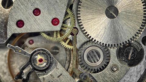 Macro shot of Clockwork Mechanism inside a Watch Footage
