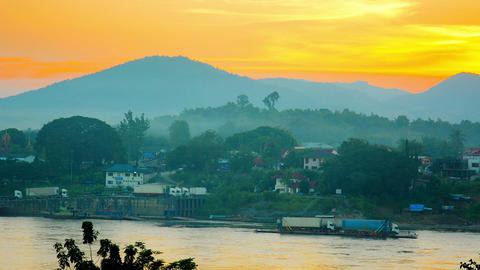 Cargo Trucks on River Barge at Sunset in Laos Footage
