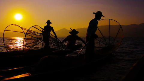 Burmese fishermen after the fishing. Evening on Inle Lake. Myanmar Footage