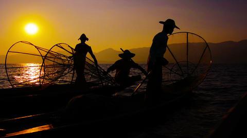 Burmese fishermen after the fishing. Evening on Inle Lake. Myanmar Footage