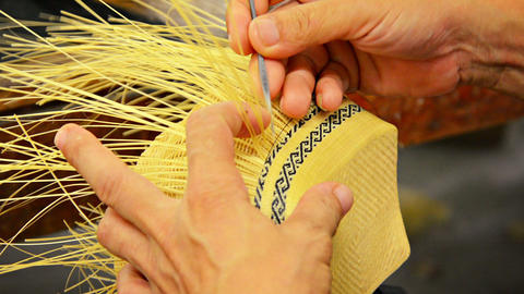 Local Artisan Creates Intricate Patterns in Straw Basket Footage
