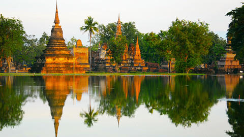 Ancient Buddhist Temples Reflected in a Pond Footage