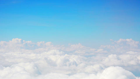 Soft. Fluffy Clouds under a Blue Sky Footage