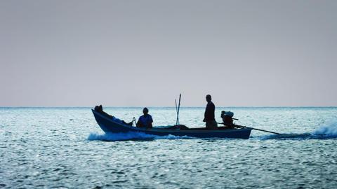 KAMALA. PHUKET. THAILAND - CIRCA DEC 2014: Silhouette of local fishermen cruisin Live Action