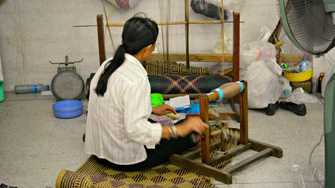 BANG PA-IN. THAILAND - CIRCA NOV 2013: Local artisan spinning thread by hand in  Live Action