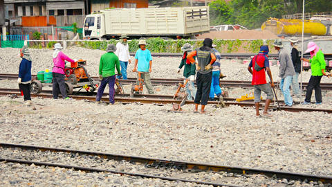BANG PA-IN. THAILAND - CIRCA NOV 2013: Laborers performing track maintenance on Footage