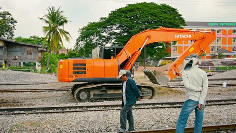 LOPBURI. THAILAND - CIRCA NOV 2013: Tracking shot of hydraulic excavagtor raking Footage