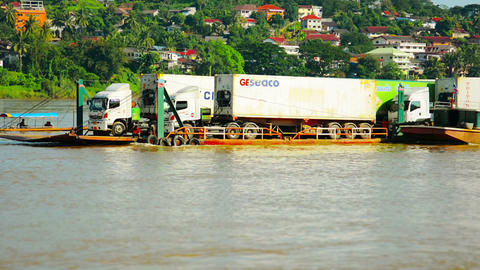 HUAY HAI. LAOS - CIRCA DEC 2013: Tractor-trailer Cargo Trucks Being Floated Upri stock footage