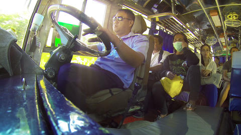HUAY HAI. LAOS - CIRCA DEC 2013: Low-angle Shot Of A Very Relaxed Bus Driver And stock footage