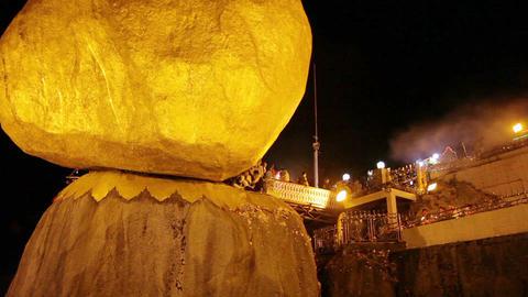MON STATE. MYANMAR - 04 JAN 2014: Night pilgrimage near Buddhist relics - the go Footage