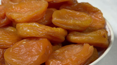 Bright Dried Apricots on a Plate HD Footage