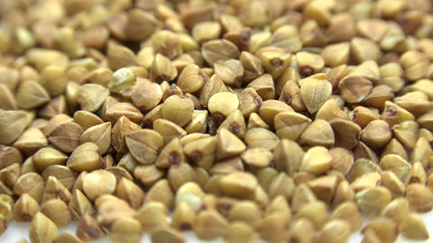High Resolution Macro of Dry Buckwheat Grain. Dolly Shot. 4K UltraHD, UHD Footage