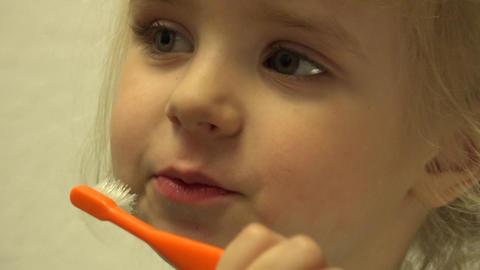 Cute Little Girl is Cleaning Teeth Using Toothbrush. 4K UltraHD, UHD Footage