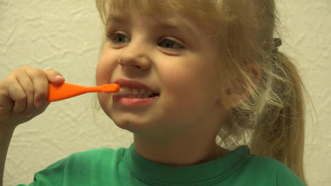 Cute Little Girl Is Cleaning Teeth Using Toothbrush. 4K UltraHD, UHD stock footage