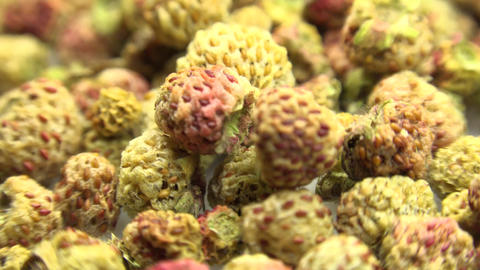 Background of dried strawberry. Motorized Dolly Shot. Macro. 4K UltraHD, UHD Footage