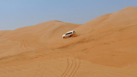 4WD car driving over dunes in oman desert Footage