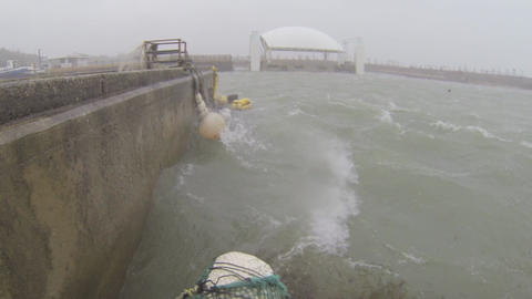 Storm Tide Rushes Into Harbor In Hurricane Footage