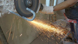 Cutting metal with an angle grinder Footage