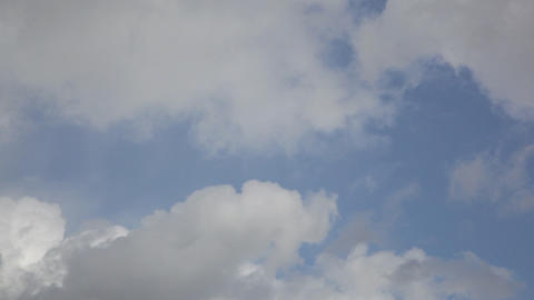 Birds fly against moving clouds Footage