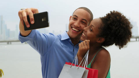 African American Couple Shopping Taking Selfie With Mobile Phone Footage