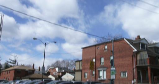 Establishing shot of parking lot in small neighbourhood in Toronto Footage