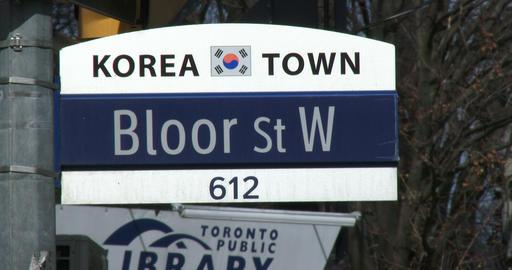 Street sign of Bloor street in Korea town neighbourhood in Toronto Footage