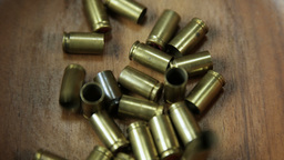 Bullet Casings Collecting In Wodden Bowl 4 K UHD stock footage