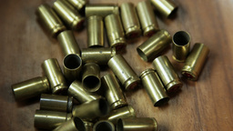 Group of bullet shells center frame 4 K UHD Archivo