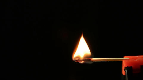 Matchstick igniting against black background 02 Archivo