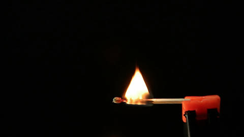Matchstick igniting against black background 03 Footage