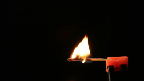 Matchstick igniting against black background 05 Archivo