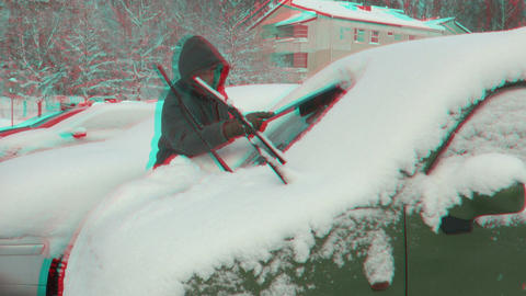 Stereoscopic 3D of cleaning car window after snow storm 1 combo Footage