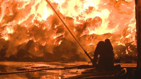2 firemen fight a fire Stock Video Footage
