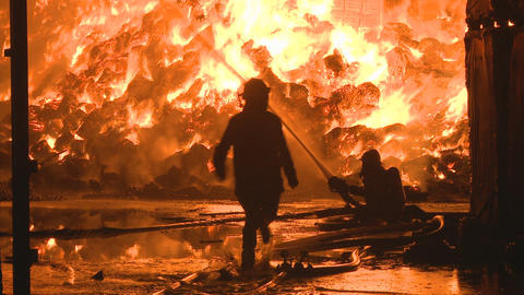 Fighting large industrial fire Stock Video Footage
