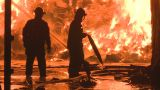 Firemen fighting a large industrial fire Footage