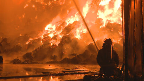 Fireman fights fire Stock Video Footage