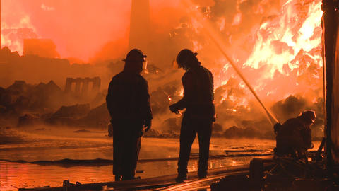 three firemen fighting a fire Stock Video Footage