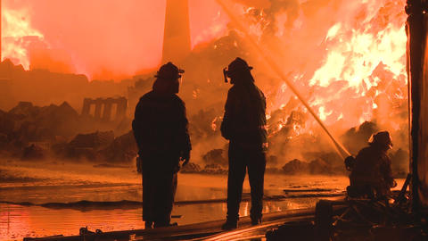 three firemen fighting a fire Footage