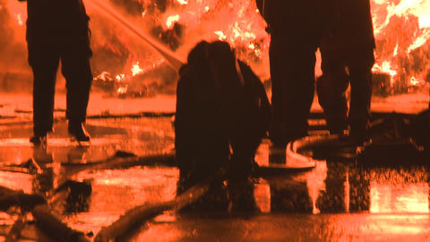 Firemen at a large industrial fire Stock Video Footage