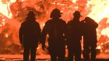 Firemen at a large industrial fire Footage