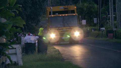 garbage trucks in paradise Stock Video Footage