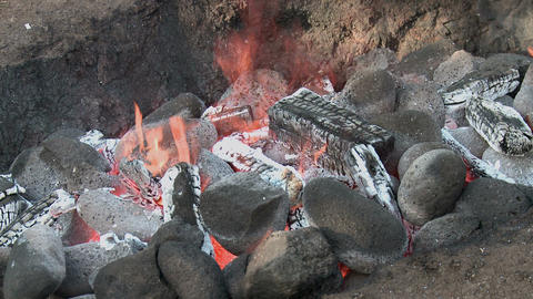 Hawaiian Imu pit fire detail 2 Stock Video Footage