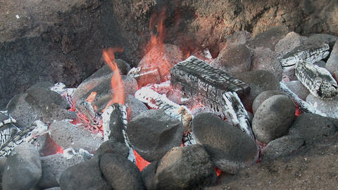 Hawaiian Imu pit fire detail 2 Stock Video Footage