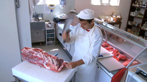 butcher cutting meat Stock Video Footage