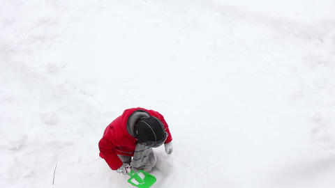 Boy play in snow 2 Stock Video Footage