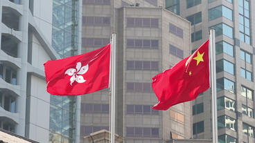 Flags of China and Hong Kong SAR waving in the wind Archivo