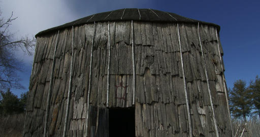Iroquois longhouse in a reconstructed 15th century Iroquoian village in Canada Footage