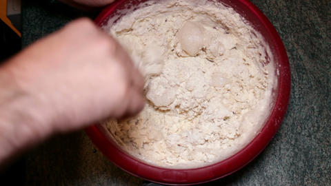 Hand stirring leaven and flour - dough mixture Footage