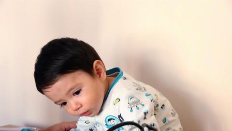CLOSE UP-HANDHELD SHOT. Child Holds A Stetoscope During A Medical Check Up stock footage