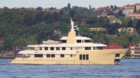 Luxury large yacht sailing into Bosphorus waters along mansions of Istanbul City Footage